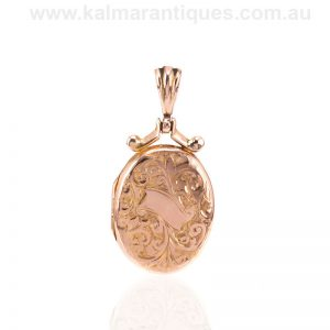 Antique rose gold antique photo locket made in 1915