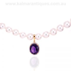 18 carat gold Amethyst and diamond enhancer pendant
