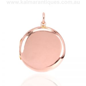 Round antique rose gold locket made in 1916