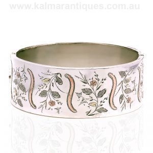 Antique sterling silver bangle with rose and yellow gold