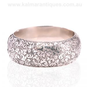 Exquisitely hand engraved antique sterling silver hinged bangle