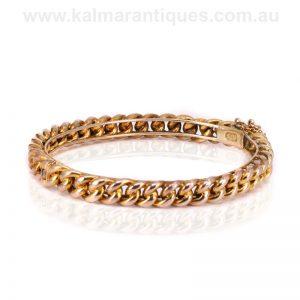 Elegant 9 carat antique curb link designed hinged bangle