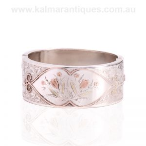 Antique bangle made in silver and highlighted with rose and green gold