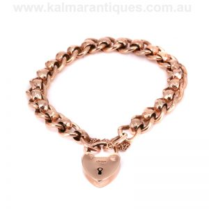 Antique rose gold curb and roller ball padlock bracelet
