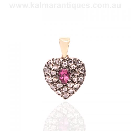 Antique heart shaped pendant set with a tourmaline and rose cut diamonds