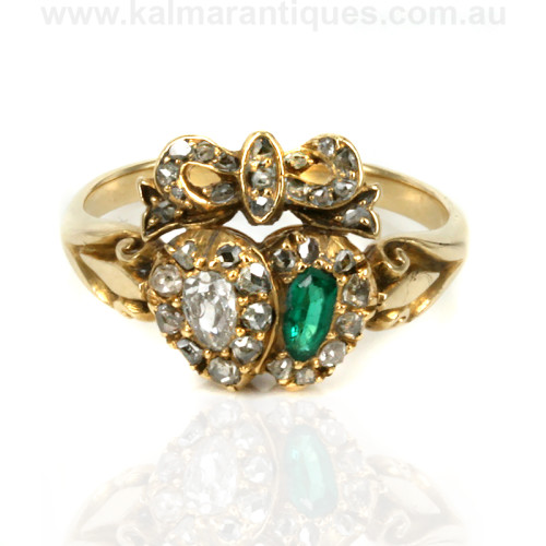 Antique double heart emerald and diamond ring