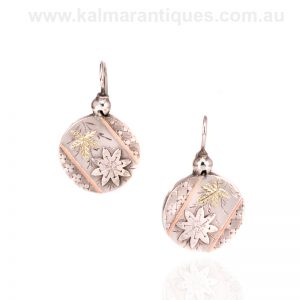 Antique sterling silver earrings highlighted with rose and green gold