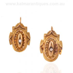 Antique rose gold earrings each set with a pearl made in 1892