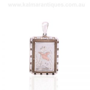 Antique sterling silver locket with a rose gold bird on the front