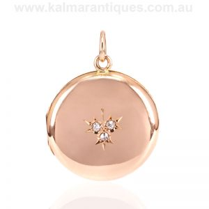 Antique 15 carat gold locket set with diamonds