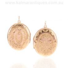 Antique hand engraved locket with grapes on one side