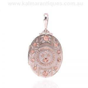 Antique sterling silver and rose gold photo locket made in 1885