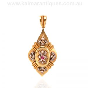 Antique ruby, diamond and pearl pendant with a locket on the reverse side
