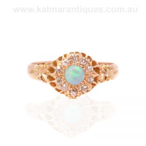Antique opal and diamond cluster ring made in the early 1900's