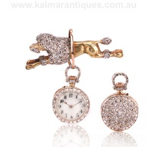 Antique diamond poodle brooch set with a diamond pocket watch
