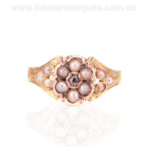 Antique pearl and diamond ring with a locket compartment