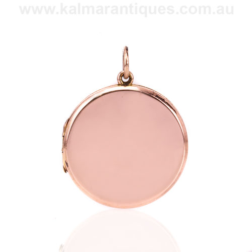 Plain double sided 9ct rose gold photo locket made in 1919