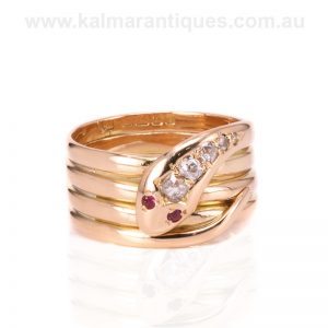 18 carat gold antique snake ring set with rubies and diamonds.