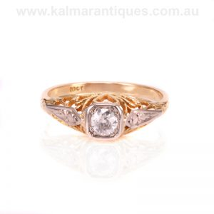 Art Deco diamond engagement ring with a heart design on each side.