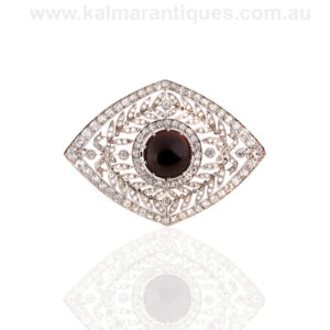 French Art Deco garnet and diamond brooch in platinum
