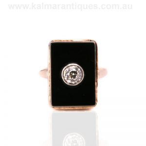 18 carat rose gold onyx and diamond ring dating from the 1920's