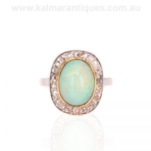 Art Deco opal ring surrounded by rose cut diamonds