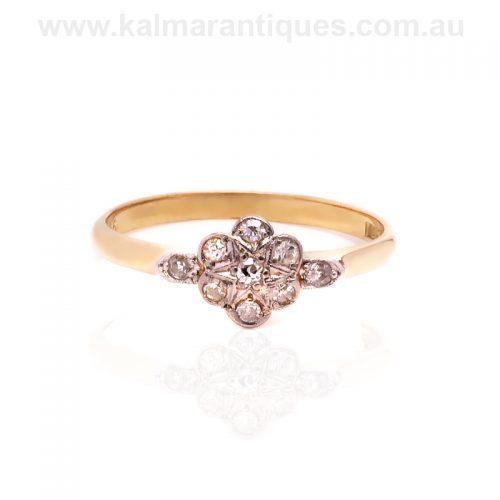 Art Deco era diamond cluster ring with a star design