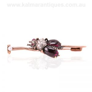Antique fly brooch set with garnets, rubies and diamonds