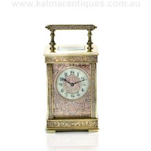Antique carriage clock in a beautiful and rare two colour engraved case