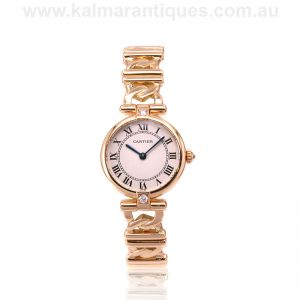 Ladies 18 carat gold diamond set Cartier watch