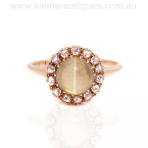 Antique chrysoberyl cat's eye and diamond cluster ring