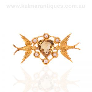 Antique brooch with a citrine love heart and two swallows