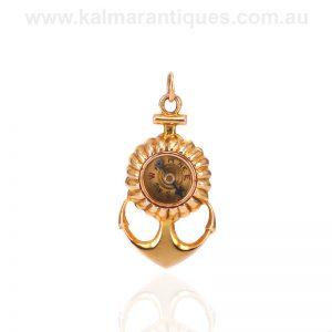Antique 9 carat gold anchor pendant set with a compass