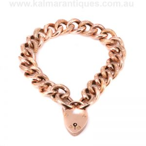Antique 9 carat rose gold curb link night and day padlock bracelet