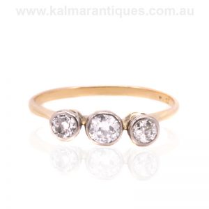 Three stone Art Deco era diamond engagement ring