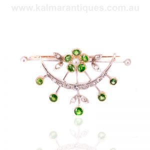 Antique demantoid garnet, pearl and diamond brooch made in the 1890's