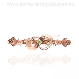 Antique demantoid garnet and rose cut diamond brooch