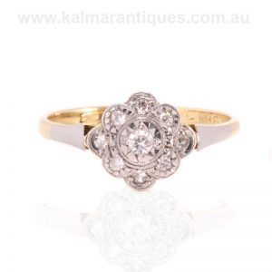 Art Deco diamond halo engagement ring made in the 1920's