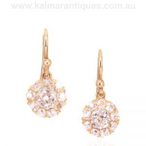 Antique diamond cluster earrings set with mine cut diamonds