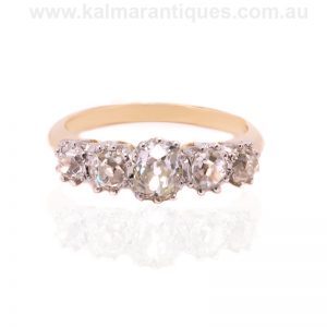 Handmade gold and platinum diamond engagement ring set with antique diamonds