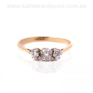 Elegant three stone Art Deco diamond engagement ring