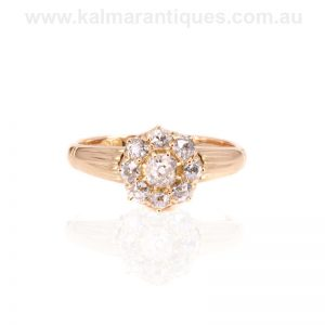 Antique diamond engagement ring set with mine cut diamonds