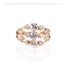 Antique ring set with mine cut diamonds in 18 carat gold