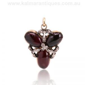 Antique garnet and diamond locket pendant dating from the 1870's
