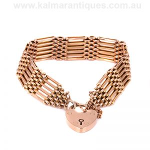Antique six row rose gold gate link bracelet with a heart shaped padlock