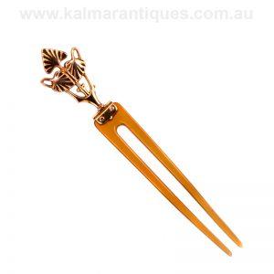 Art Nouveau era horn hair pin set with a 9 carat rose gold top