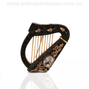 Irish harp brooch made from bog oak, 15 carat gold and set with an aquamarine