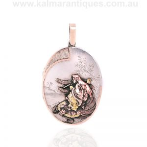 Antique sterling silver locket highlighted with rose and green gold
