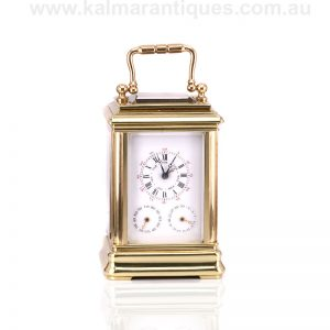 Exceedingly rare triple date miniature carriage clock