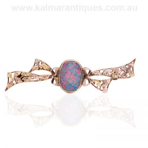 Art Deco opal doublet brooch set in rose and yellow gold
